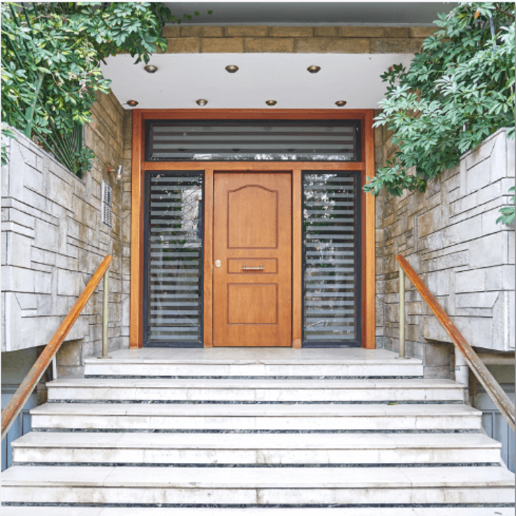 stairs leading up to a solid wood entry door