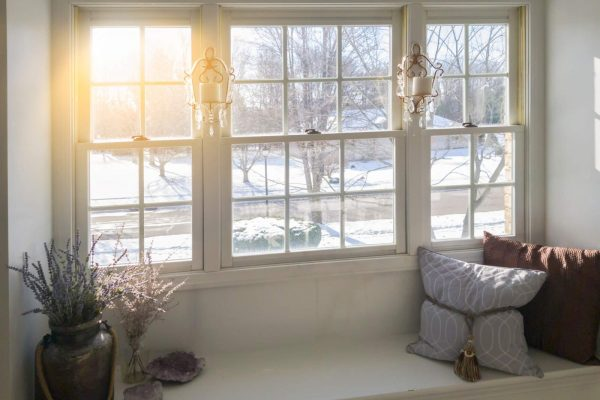 Can I Replace My Windows In The Winter?- residential windows looking out onto a snowy landscaping