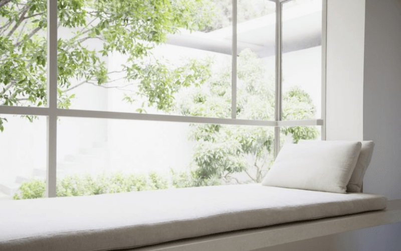 sitting bench by large window